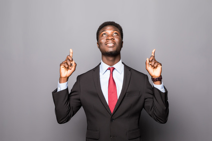 Black business man pointing up isolated over white